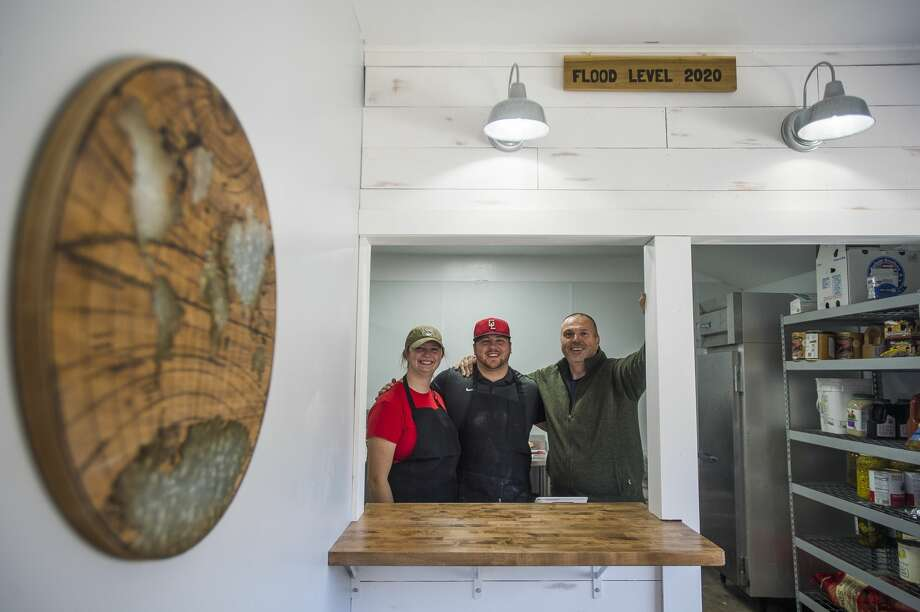 From left, Abbi Brady, Jack Brady and Mike Brady pose for a photo inside the business as it reopens Saturday, Oct. 24, 2020, for the first time since the building was damaged during the May 19 dam failures and flooding. (Katy Kildee/kkildee@mdn.net) Photo: (Katy Kildee/kkildee@mdn.net)