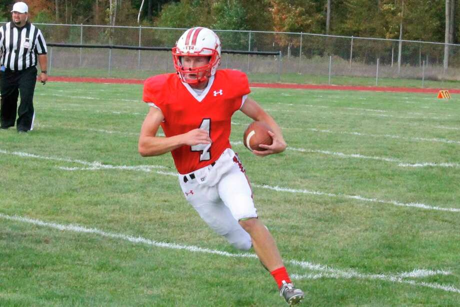 Ike Koscielski carries the ball for the Huskies during their Sept. 26 victory over Cheboygan. (File photo)