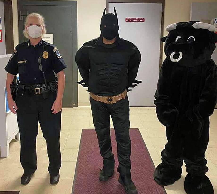 """""""Buddy the Beefalo"""" got in the spirit of things by showing up Halloween """"Trunk of Treat"""" event at the Plymouth police department on Friday, Oct. 23, 2020. In this photo, Buddy's superhero status was assured Friday when Batman, the """"Caped Crusader,"""" posed in photo with Buddy and Police Chief Karen Krasicky. The real Buddy, has become a folk hero or sorts after he escaped from the loading dock dock of a Terryville slaughterhouse on Aug. 3, 2020. Photo: Plymouth Police Department Photo"""