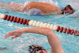 North Haven's Maddie Bergin swims the freestyle during a meet in 2019.