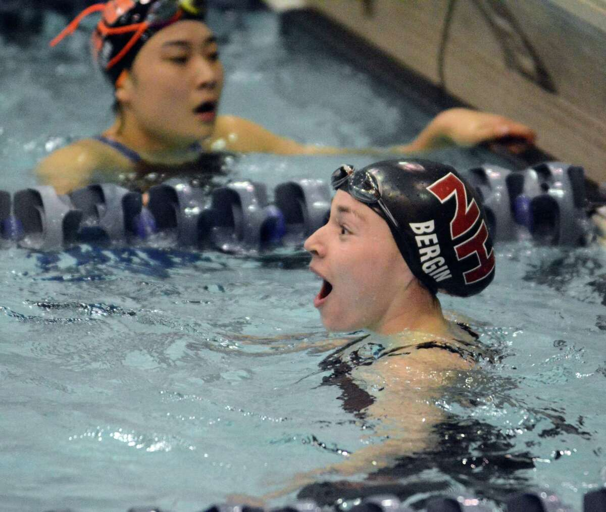 North Haven's Maddie Bergin reacts after winning the 100 freestyle during meet in 2017.