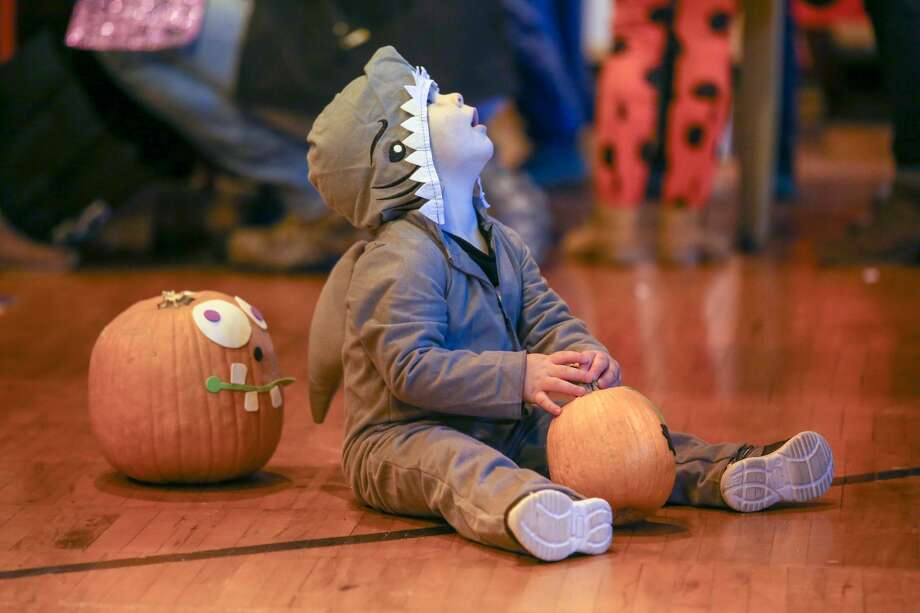 Kids and their parents filled the historic gym in Port Austin Saturday for Pumpkin Palooza. There were all sorts of kids games, treats and prizes for participants. Photo: Eric Young/Huron Daily Tribune / Huron Daily Tribune 2020