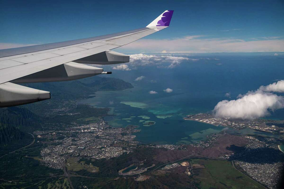 The view of the windward side of Oahu, from aboard a Hawaiian Airlines flight from Los Angeles International Airport to Honolulu International Airport.