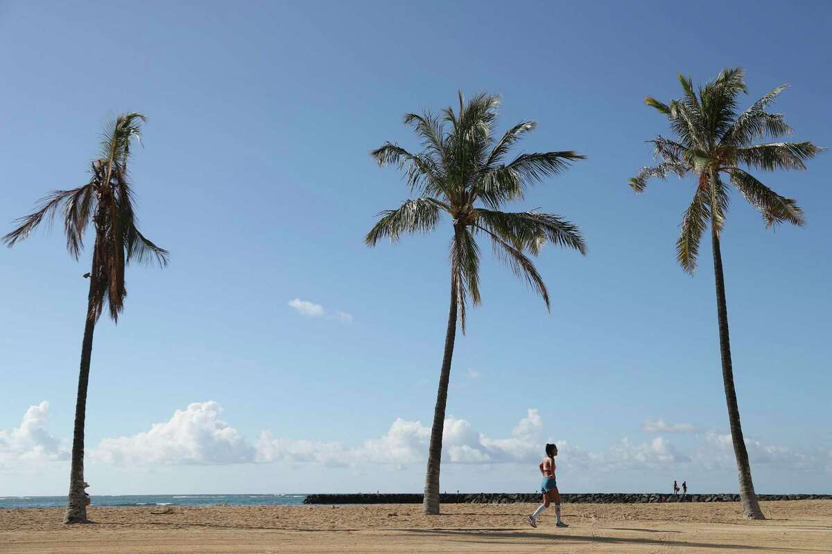 Tourists return to Hawaii amid ever-changing pandemic rules