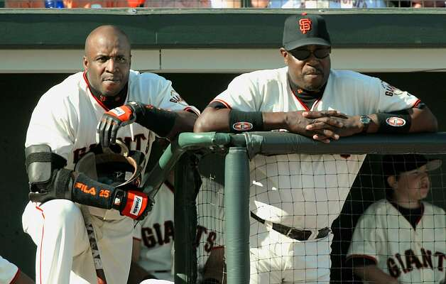 SAN FRANCISCO, UNITED STATES:  Barry Bonds (L) and manager Dusty Baker (R) of the San Francisco Giants watch from the dugout 12 October 2002, during game 3 of the National League Championship Series against the St. Louis Cardinals at Pacific Bell Park in San Francisco, CA. The Giants lead 2-0 in the best-of-seven series. AFP PHOTO/Jeff HAYNES (Photo credit should read JEFF HAYNES/AFP/Getty Images) Photo: Jeff Haynes / AFP/Getty Images 2002
