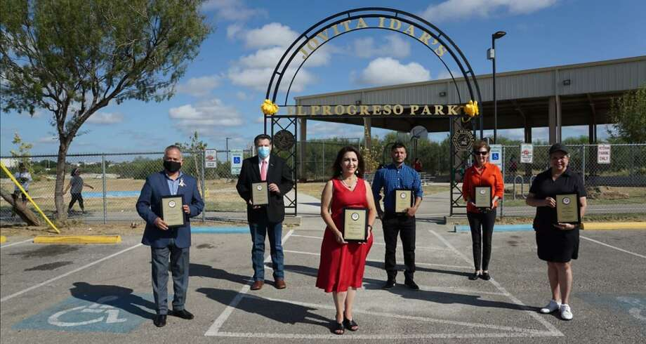 "Bartlett Park was rebranded as Jovita Idar ""El Progreso"" Park on Friday, complete with a mural of Jovita Idar by a local artist. Pictured are District III council member Mercurio Martinez III, Laredo Mayor Pete Saenz, District V council member Nelly Vielma, artist Abel Gonzalez; Webb County Heritage Foundation Executive Director Margarita Araiza and Laredo College professor Diana E. Espinoza. Photo: Courtesy /City Of Laredo"
