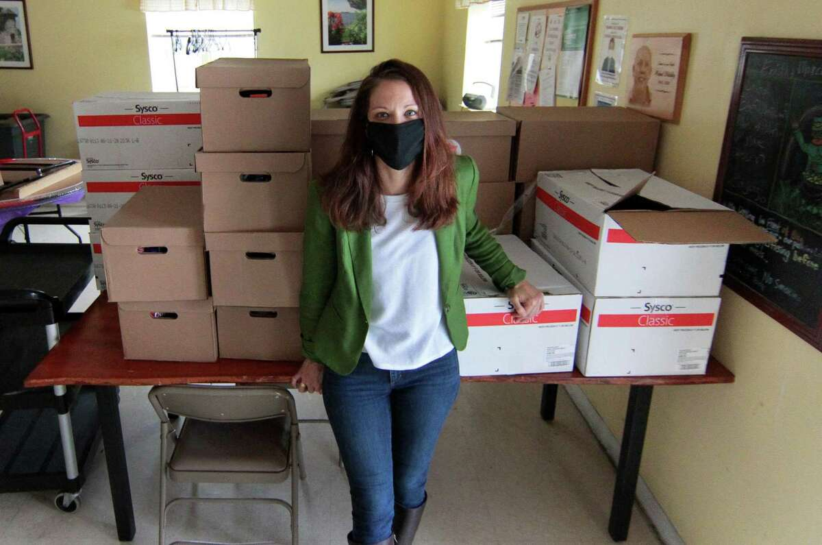 Beth-El Center, Inc. Executive Director Jenn Paradis poses in the converted soup kitchen in Milford. Food is now picked up by clients or delivered directly. The shelter and soup kitchen has seen an increase in services they're providing due to the economic effects of the coronavirus pandemic.