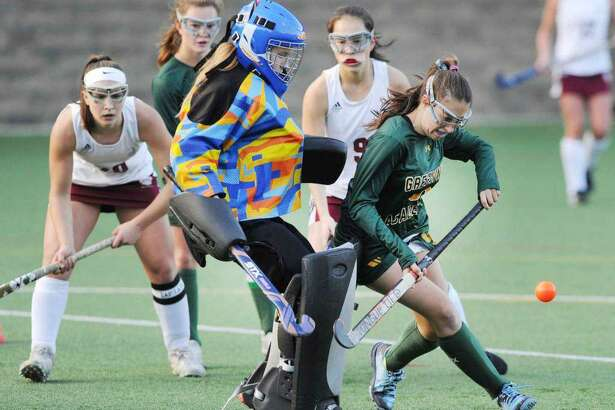 In this game against Loomis Chaffee School in 2018, Julia Freedman of Greenwich Academy, right, takes a shot on goal. Freedman is one of the senior captains of the Greenwich Academy field hockey team this season.
