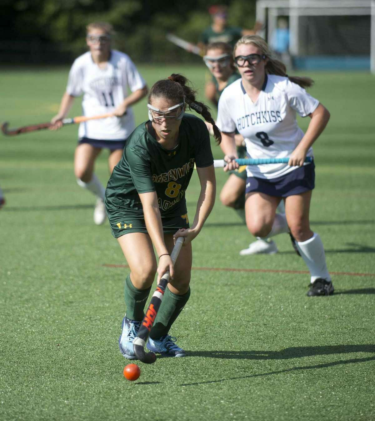 Julia Freedman moves the ball up the field for Greenwich Academy in its game against Hotchkiss School in 2019. Freedman is one of the senior captains of the Greenwich Academy field hockey team this season.