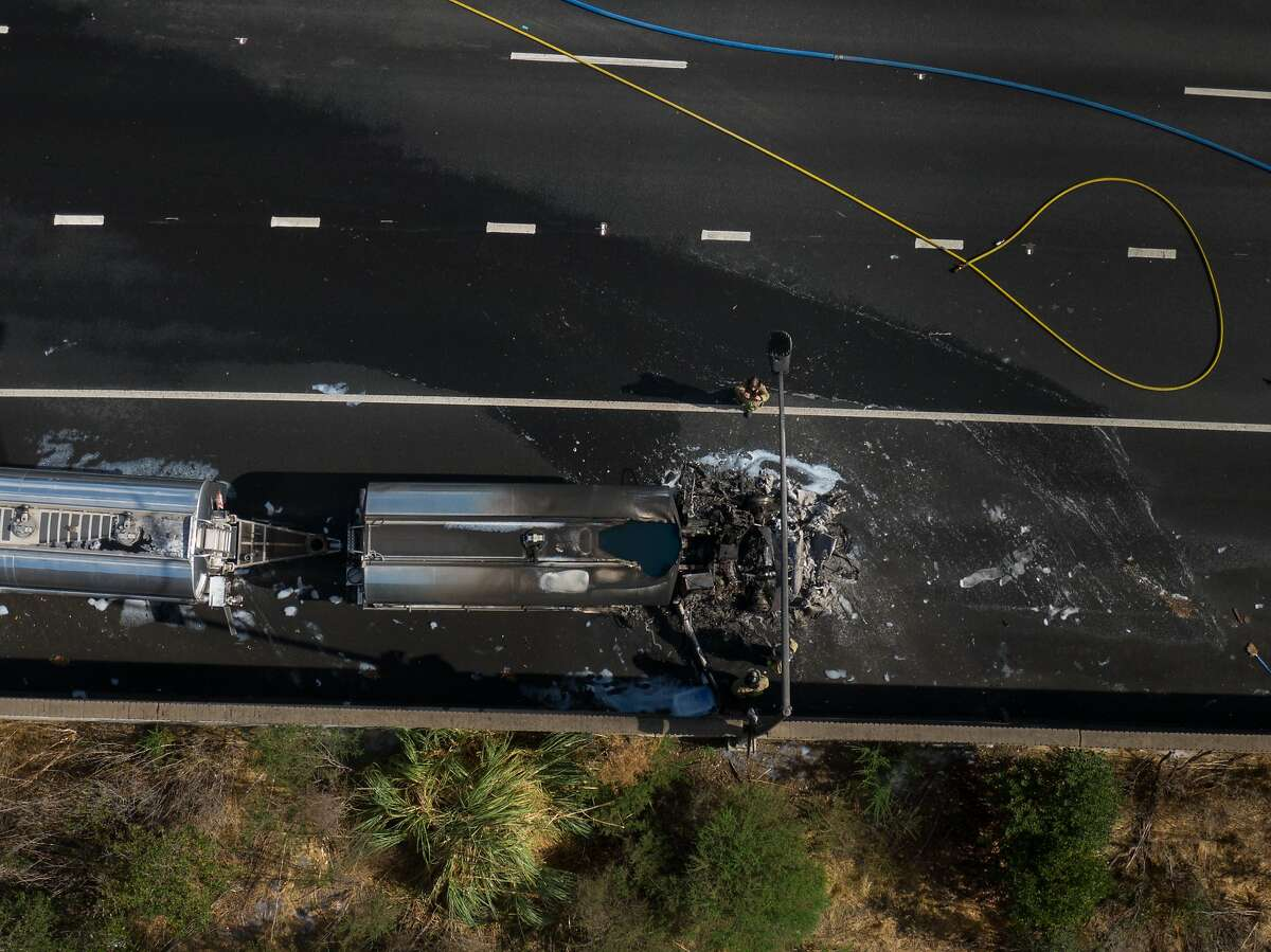 Firefighters inspect damage to a fuel truck after a blaze on Interstate 80 in Richmond.