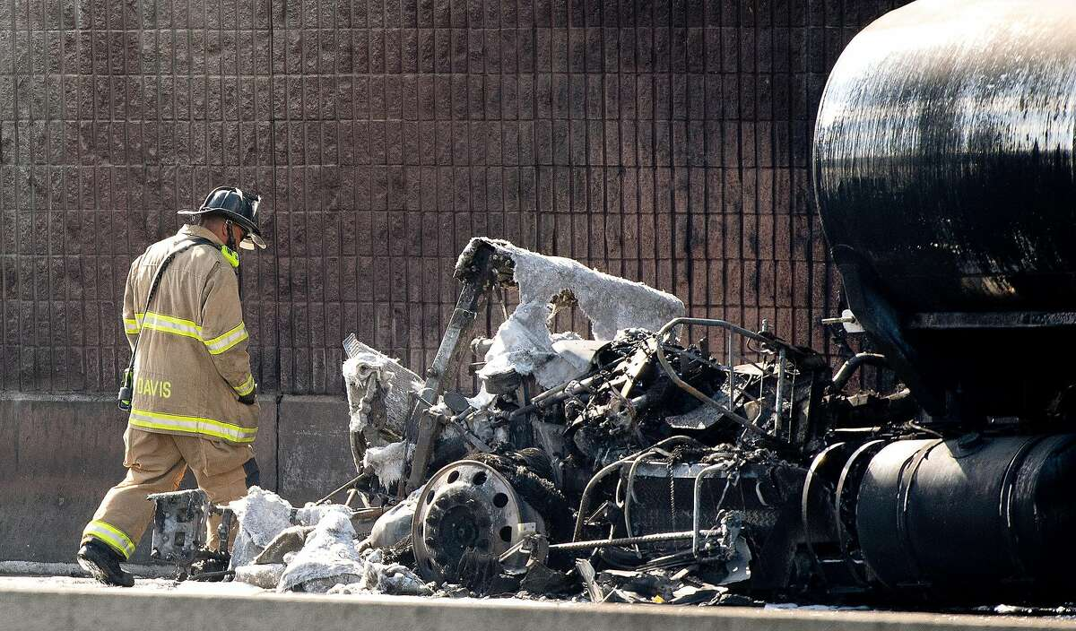 A hazardous materials crew member inspects the damage to a fuel truck that burned on Interstate 80 in Richmond.