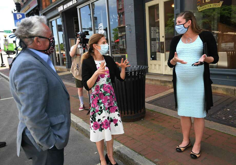 From left; Norwalk Mayor Harry Rilling, Lt. Governor Susan Bysiewicz, and Norwalk Chief of Economic Development Jessica Casey chat during a walking tour of the Washington Street retail and restaurant district in Norwalk, Conn. on Wednesday, May 27, 2020. As Norwalk endures a COVID spike, with 163 infections reported in the week ending Oct. 17, Rilling wants the state to revert to a one-size-fits-all standard for reopening the economy. Photo: Brian A. Pounds / Hearst Connecticut Media / Connecticut Post