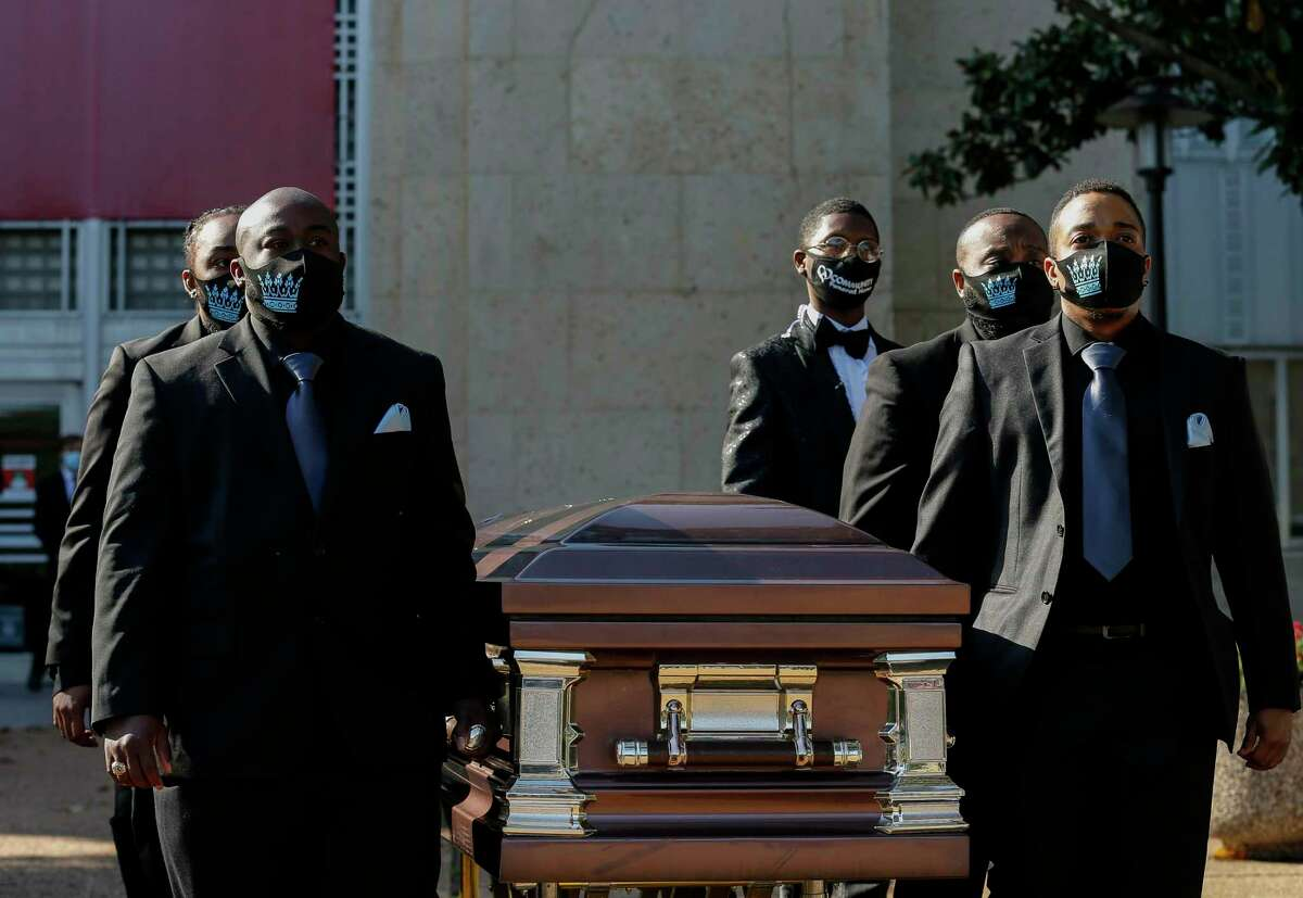 Pallbearers escort the casket carrying the body of transgender rights advocate Monica Roberts, 58, to the hearse at the Cullen Performance Hall of the University of Houston on Saturday, Oct. 24, 2020, in Houston.