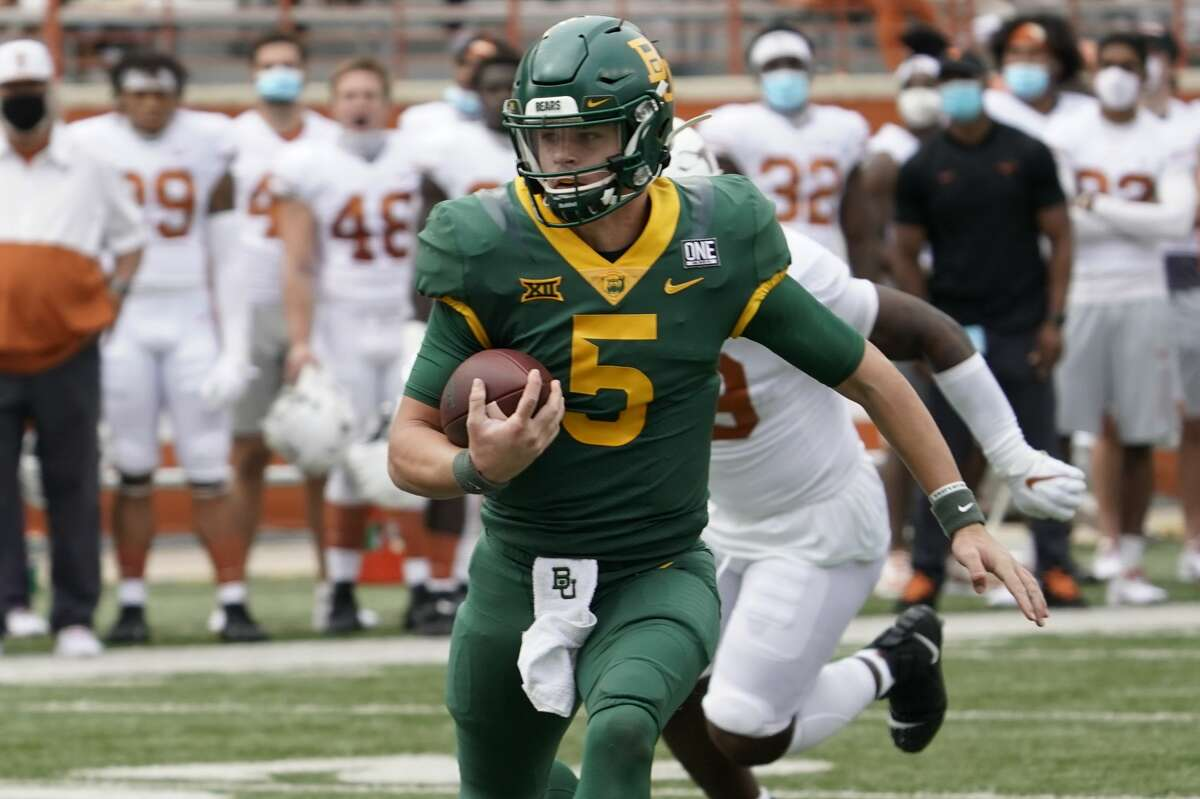 Baylor's Charlie Brewer (5) scrambles against Texas during the first half of an NCAA college football game in Austin, Texas, Saturday, Oct. 24, 2020. (AP Photo/Chuck Burton)