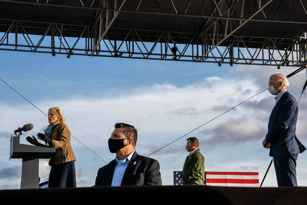 Jill Biden delivers remarks during a drive-in event for her husband, presidential nominee Joe Biden, at Dallas High School in Dallas, Pa. Jon Bon Jovi took part in the event.