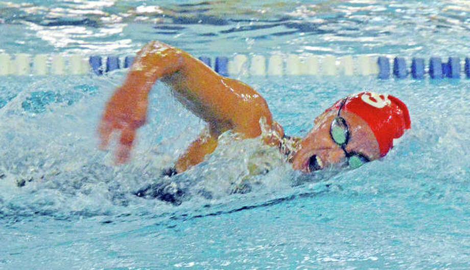Eleni Kotzamanis of Alton High swim the 200-yard freestyle at Saturday's IHSA Girls Sectional meet at the Chuck Fruit Aquatic Center in Edwardsville. Kotzamanis was second in the event and was second in the 500-yard freestyle. She finished first in the 100-yard backstroke. Photo: Scott Marion | Hearst Illinois