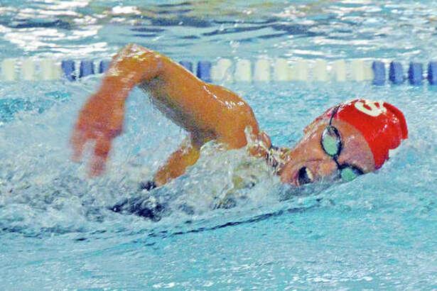 Eleni Kotzamanis of Alton High swim the 200-yard freestyle at Saturday's IHSA Girls Sectional meet at the Chuck Fruit Aquatic Center in Edwardsville. Kotzamanis was second in the event and was second in the 500-yard freestyle. She finished first in the 100-yard backstroke.