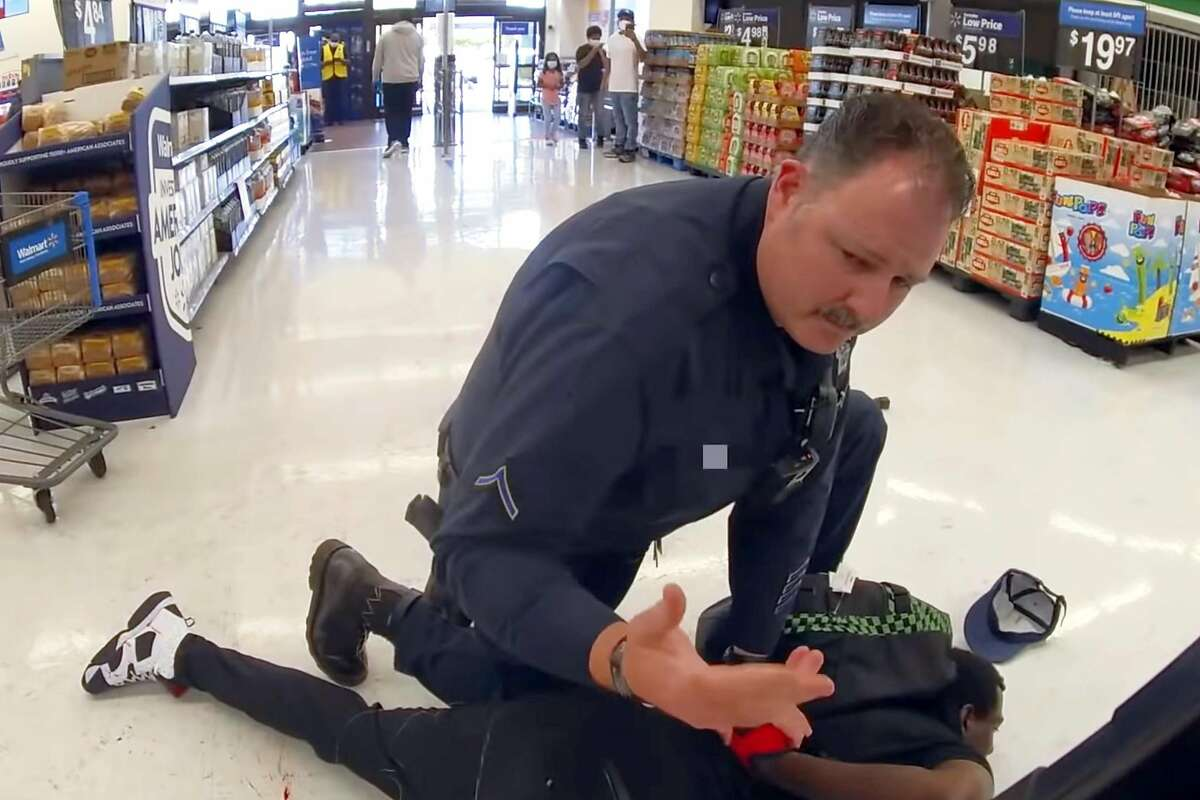 A screenshot from body camera footage of Officer Jason Fletcher handcuffing Steven Taylor after shooting him inside a San Leandro Walmart on April 18, 2020.