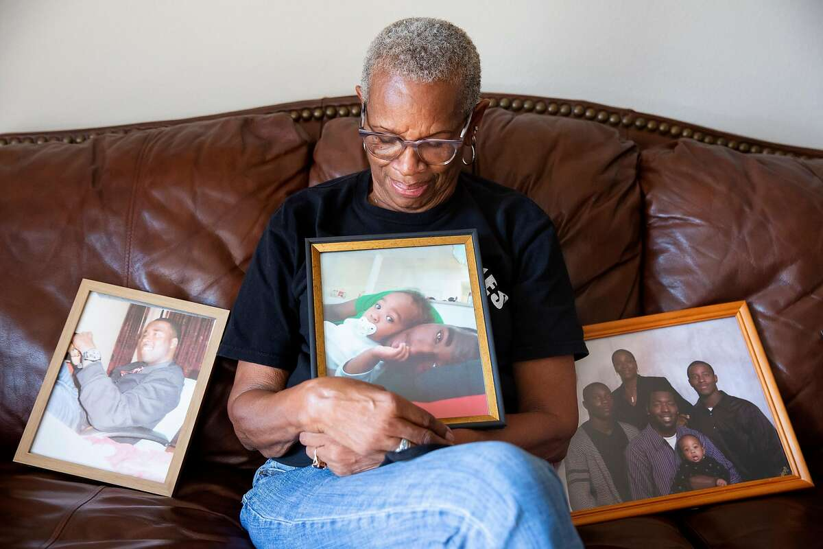 Addie Kitchen of Vallejo shows pictures that include her grandson, Steven Taylor, who was fatally shot in April by an officer after waving a bat at customers in a San Leandro Walmart.