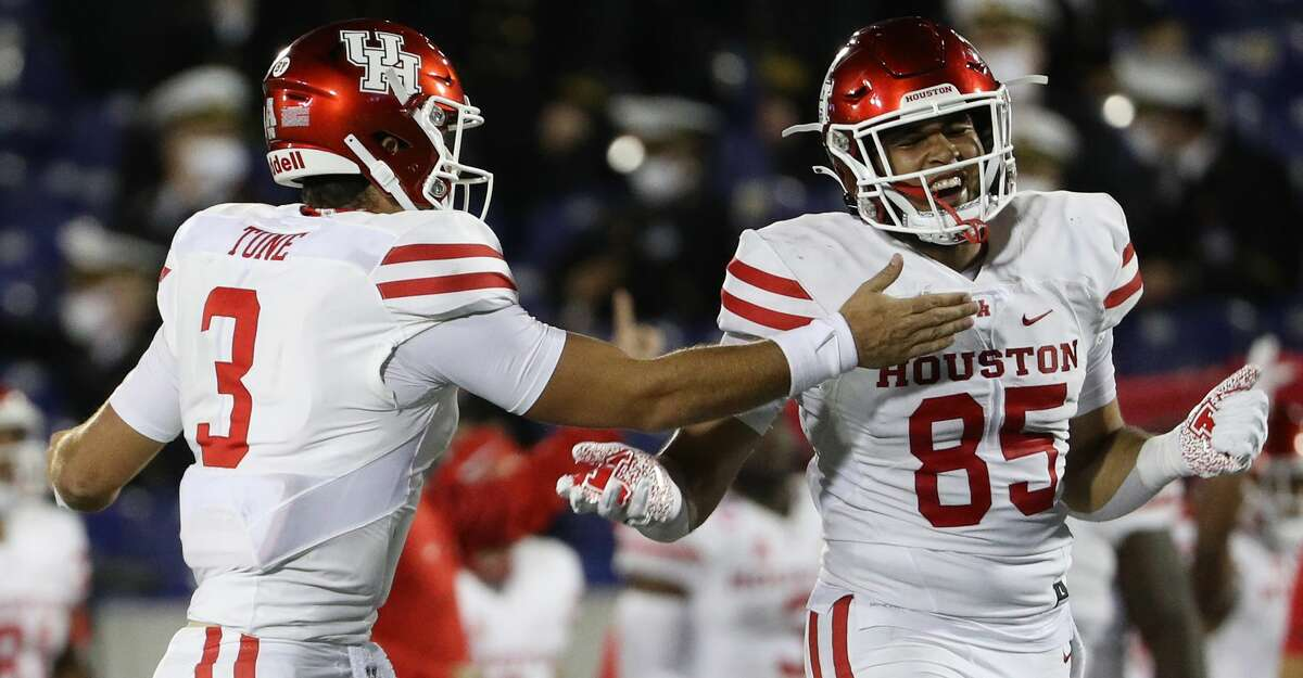 Quarterback Clayton Tune #3 of the Houston Cougars celebrates a touchdown with teammate tight end Christian Trahan #85 against the Navy Midshipmen during the fourth quarter at Navy-Marine Corps Memorial Stadium on October 24, 2020 in Annapolis, Maryland. (Photo by Patrick Smith/Getty Images)