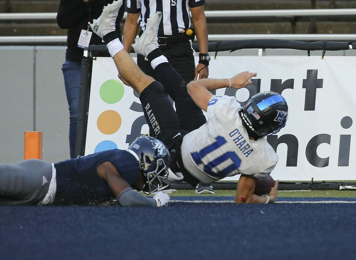 Middle Tennessee Blue Raiders quarterback Asher O'Hara (10) scores a touchdown during the double overtime of a CUSA conference game against Rice Owls Saturday, Oct. 24, 2020, at Rice Stadium in Houston. Middle Tennessee Blue Raiders defeated Rice Owls 40-34 in double overtime.