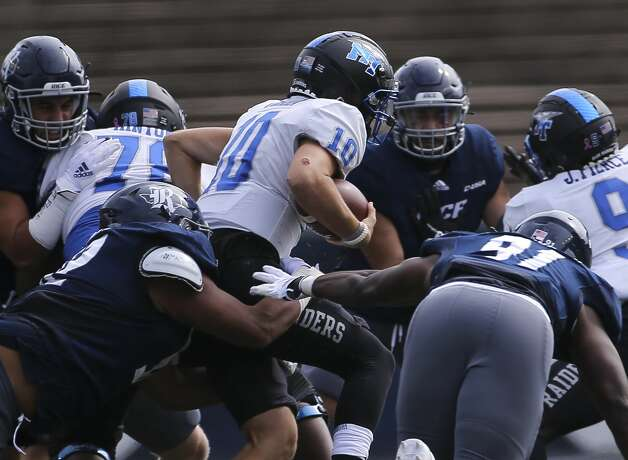Rice Owls players tackle Middle Tennessee Blue Raiders quarterback Asher O'Hara (10) during the first quarter of a CUSA conference game Saturday, Oct. 24, 2020, at Rice Stadium in Houston. Photo: Yi-Chin Lee/Staff Photographer / © 2020 Houston Chronicle