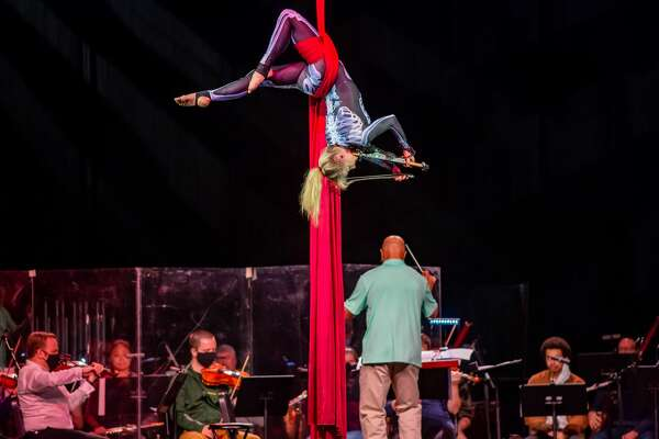 A member of Cirque de la Symphonie flies over the stage as she rehearses with the Symphony of Southeast Texas for Saturday night's performance. Saturday evening, the Symphony of Southeast Texas presented Cirque Spooktacular at the Beaumont Civic Center with performers from Cirque de la Symphonie. Photo made on October 24, 2020. Fran Ruchalski/The Enterprise