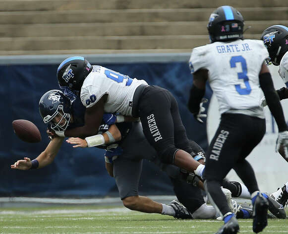 Rice Owls quarterback Mike Collins (4) fumbles during the third quarter of a CUSA conference game against the Middle Tennessee Blue Raiders Saturday, Oct. 24, 2020, at Rice Stadium in Houston. Middle Tennessee Blue Raiders defeated Rice Owls 40-34 in double overtime. Photo: Yi-Chin Lee/Staff Photographer / © 2020 Houston Chronicle