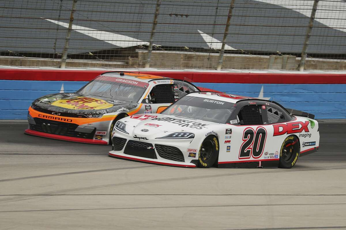 Harrison Burton (20) pulls ahead Noah Gregson (9) as they battle out of turn four down the front stretch.
