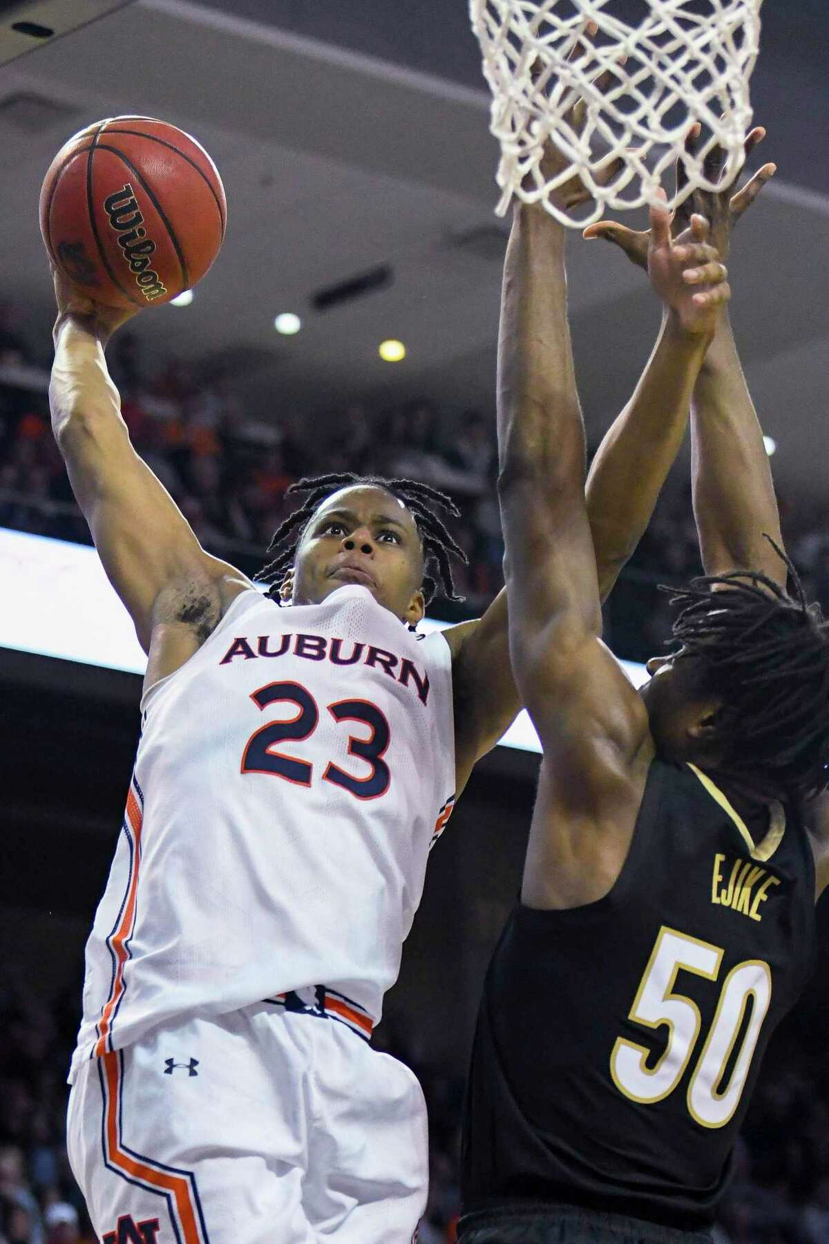 Auburn forward Isaac Okoro (23) dunks and is fouled by Vanderbilt's Ejike Obinna (50) during the second half of an NCAA college basketball game Wednesday, Jan. 8, 2020, in Auburn, Ala. (AP Photo/Julie Bennett)