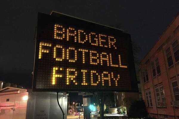 An electronic sign flashed: BADGER FOOTBALL FRIDAY, ALL LOTS CLOSED and GO BADGERS during the game on Oct. 23, 2020.