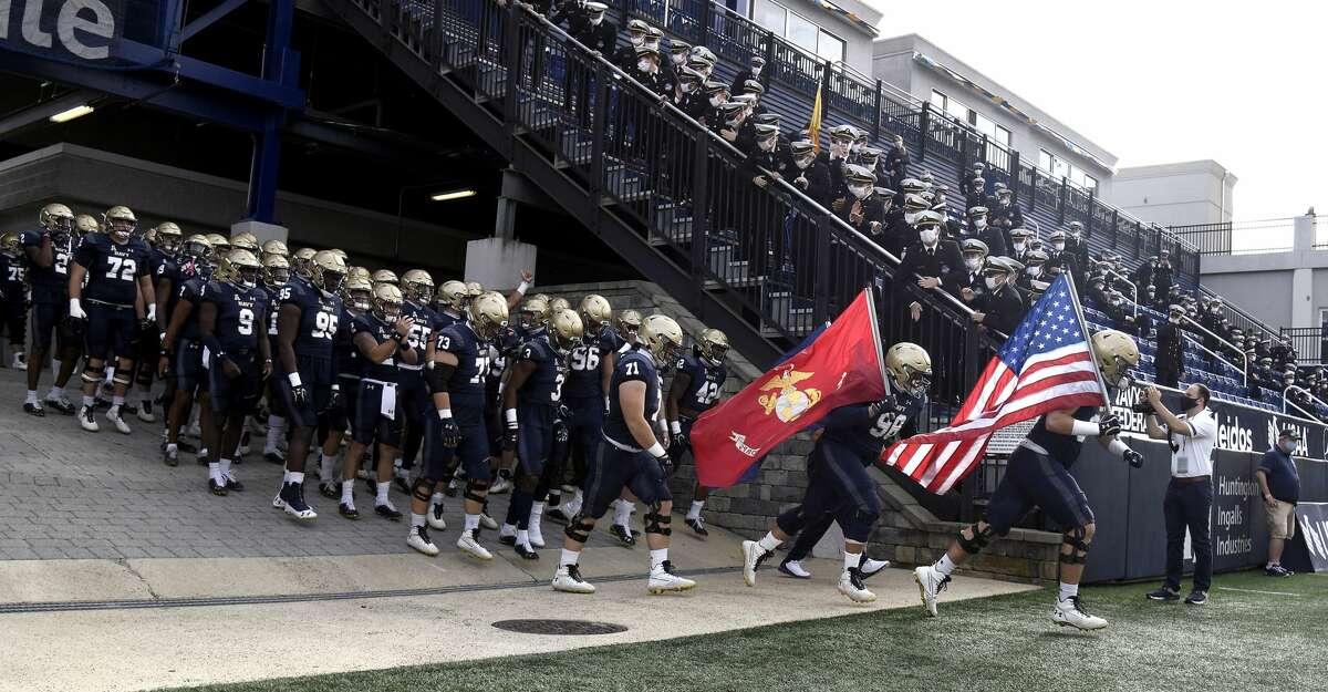 Navy exits the tunnel as the team takes the field to start an NCAA college football game against Houston in Annapolis, Md., Saturday, Oct. 24, 2020. (Paul W. Gillespie/The Baltimore Sun via AP)