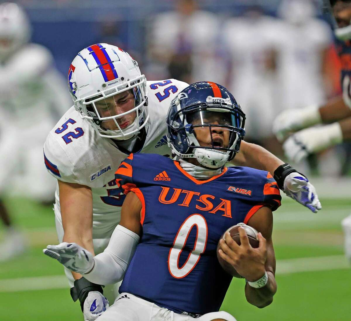 UTSA quarterback Frank Harris, getting sacked in last week's win, was sacked four times Saturday at Florida Atlantic.