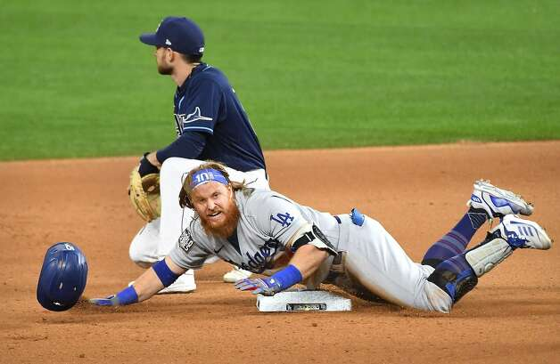 The Los Angeles Dodgers' Justin Turner slides safely into second base on a double in the seventh inning against the Tampa Bay Rays in Game 4 of the World Series at Globe Life Field in Arlington, Texas, Saturday, Oct. 24, 2020. (Wally Skalij/Los Angeles Times/TNS) Photo: Wally Skalij, TNS