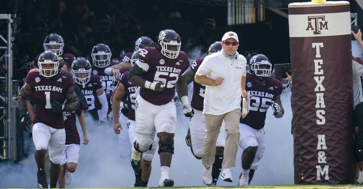 Texas A&M head coach Jimbo Fisher leads the Aggies onto the field before the start of an NCAA college football game against Florida, Saturday, Oct. 10, 2020. in College Station, Texas. (AP Photo/Sam Craft)