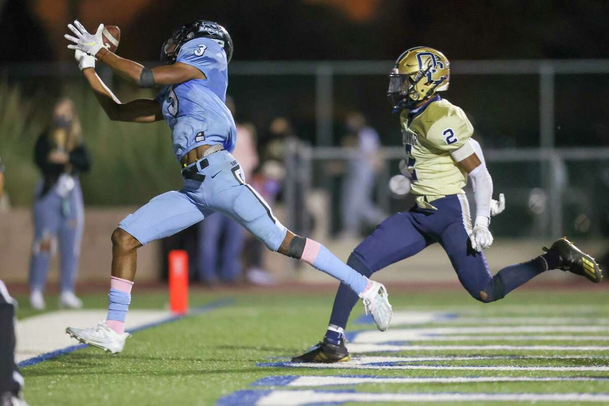 Harlan's En'dreas Spriggs tries to catch a pass in the back of the overtime past O'Connor's Gio Waller during overtime in their District 29-6A high school football game at Farris Stadium on Oct. 24, 2020. O'Connor won the game 30-27 in overtime.