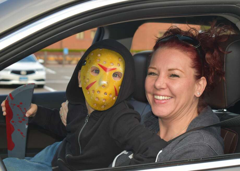 The 2020 Trunk or Treat was held as a drive-thru style, at Torrington Middle School on 10/25/20. The Parks and Rec Department hosted the event and groups from the area decorated their own vehicles and dressed up while giving treats to trick or treaters by dropping them into the trunks of vehicles. Photo: Lara Green- Kazlauskas/ Hearst Media