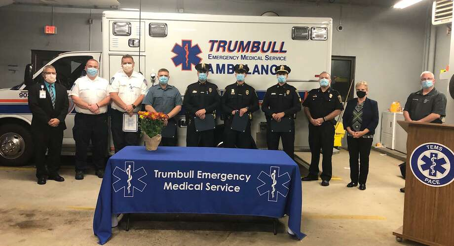 Bridgeport Hospital recently honored Trumbull emergency responders for saving the life of a 36-year-old cardiac arrest patient. From left, Bridgeport Hospital representative Paul Possenti, Paramedic Supervisor Andrew Weber, Paramedic James Bieger, EMT Trevor Bellows, Officer Jammes Sota, Officer Brian Federowicz, Sgt. Paul Coutinho, Police Chief Michael Lombardo, First Selctman Vicki Tesoro, Bridgeport Hospital EMS Manager Wes Young. Photo: Contributed / Trumbull EMS