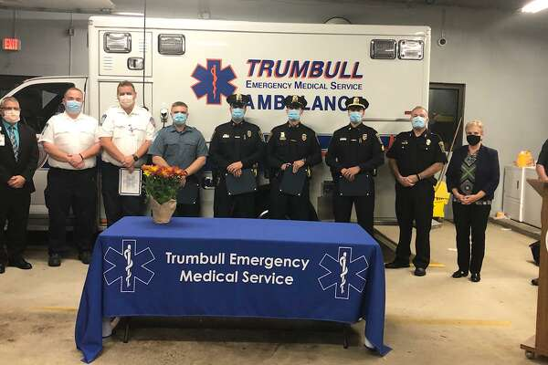Bridgeport Hospital recently honored Trumbull emergency responders for saving the life of a 36-year-old cardiac arrest patient. From left, Bridgeport Hospital representative Paul Possenti, Paramedic Supervisor Andrew Weber, Paramedic James Bieger, EMT Trevor Bellows, Officer Jammes Sota, Officer Brian Federowicz, Sgt. Paul Coutinho, Police Chief Michael Lombardo, First Selctman Vicki Tesoro, Bridgeport Hospital EMS Manager Wes Young.