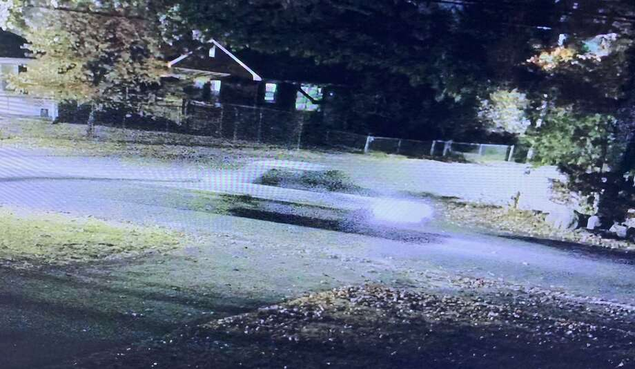Waterbury Police say this vehicle struck a pedestrian on Wolcott Street around 8:15 p.m. Saturday, Oct. 25, and fled the scene with the victim on the car. The man suffered serious injuries, police said. Photo: David Silverio / Waterbury Police / New Haven Register Contributed
