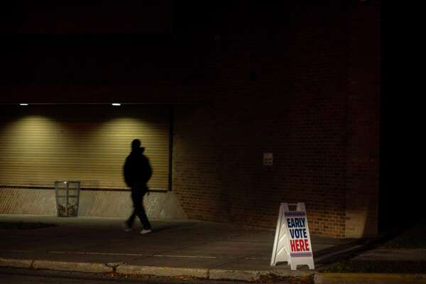 An early voting sign encourages Milwaukee residents Tuesday to place their ballots before Election Day in Wisconsin.