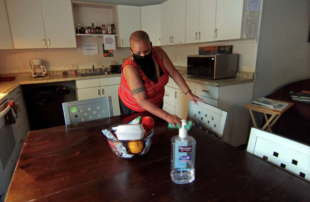 Liani Mackey, a resident at Beth-El Center, Inc., helps clean up the community kitchen.