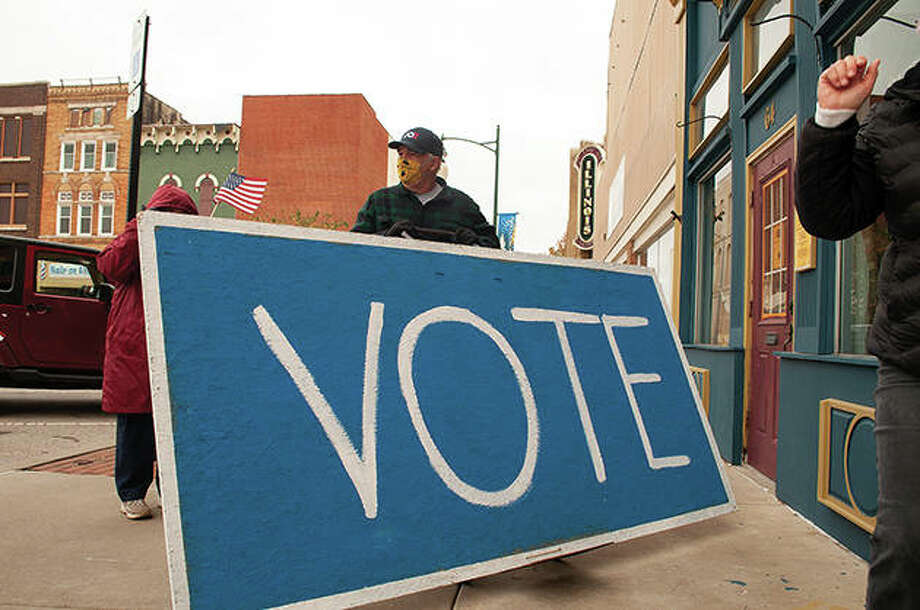 The Morgan County Democrats met at the Soap Co. Coffee House Saturday morning to walk through the square to the courthouse to promote early voting. Upward of 15 people attended and two went into the courthouse to vote. Photo: Darren Iozia | Journal-Courier