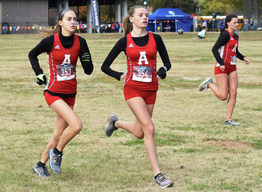 Alton's (from left) Sophia Paschal, Alayna Rabozzi and Eva Schwaab start their race Saturday at the Granite City Class 3A Regional at Wilson Park. Photo: Matt Kamp / Hearst Illinois