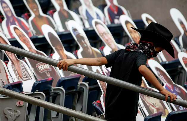 A young fan Houston Texans fan walks towards the field before an NFL game Sunday, Oct. 25, 2020, at NRG Stadium in Houston. Photo: Jon Shapley, Staff Photographer / © 2020 Houston Chronicle