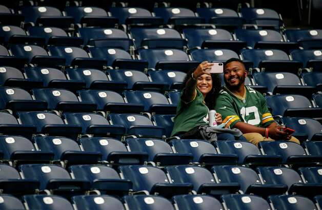 Kennedy Toungate, left, and her boyfriend Isaiah Clay take a selfie before an NFL game Sunday, Oct. 25, 2020, at NRG Stadium in Houston. Photo: Jon Shapley, Staff Photographer / © 2020 Houston Chronicle