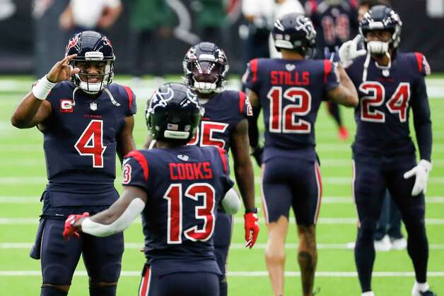 Houston Texans quarterback Deshaun Watson high fives wide receiver Brandin Cooks (13) as they run onto the field before an NFL football game against the Green Bay Packers at NRG Stadium on Sunday, Oct. 25, 2020, in Houston. Photo: Brett Coomer, Staff Photographer / © 2020 Houston Chronicle
