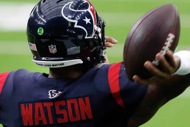 """Houston Texans quarterback Deshaun Watson wears a """"Black Lives Matter"""" sticker on the back of his helmet as he warms up before an NFL football game against the Green Bay Packers at NRG Stadium on Sunday, Oct. 25, 2020, in Houston. Photo: Brett Coomer, Staff Photographer / © 2020 Houston Chronicle"""