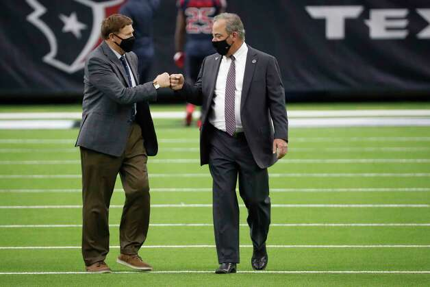 Green Bay Packers president and CEO Mark Murphy, left, fist bumps Texans chairman and CEO Cal McNair before an NFL football game at NRG Stadium on Sunday, Oct. 25, 2020, in Houston. Photo: Brett Coomer, Staff Photographer / © 2020 Houston Chronicle