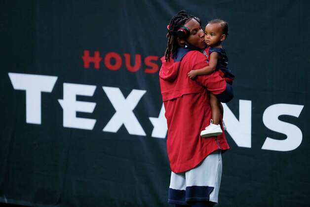 Houston Texans cornerback Lonnie Johnson kisses his daughter, Ayla, while warming up before an NFL football game against the Green Bay Packers at NRG Stadium on Sunday, Oct. 25, 2020, in Houston. Photo: Brett Coomer, Staff Photographer / © 2020 Houston Chronicle